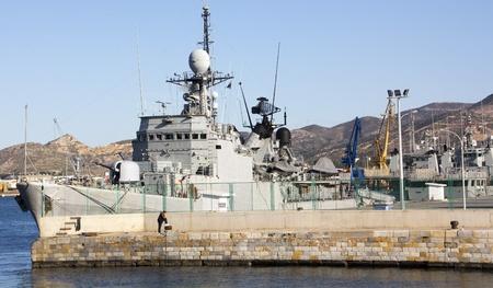 modern warship with guns and anti submarine mines