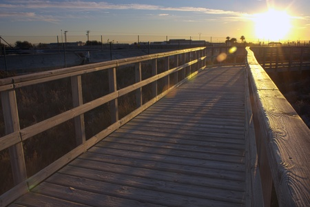 Boardwalk to Winter Beach at sunset photo