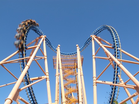 moving roller coaster with blue sky photo