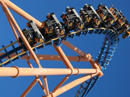 looping: moving roller coaster with blue sky