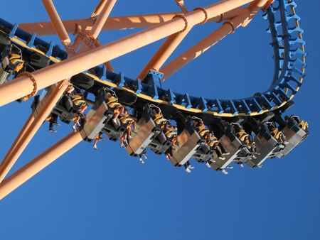 moving roller coaster with blue sky Stock Photo - 12298877