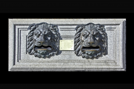 old mailbox shaped mouth of a lion photo