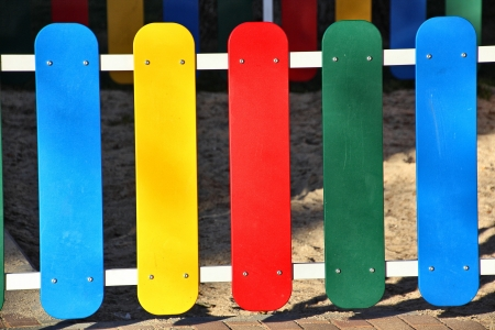 wooden fence painted in bright colors photo