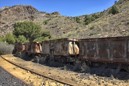 old coal wagons abandoned on the tracks photo