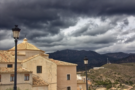 small town under storm clouds photo