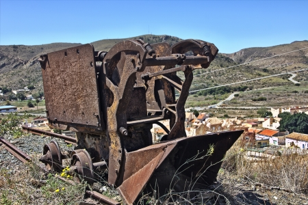 rusted old machines to collect coal from the tracks photo