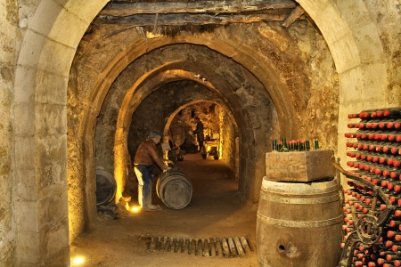 wine stocks: filling the cellar caves beneath the city of Aranda de Duero Spain