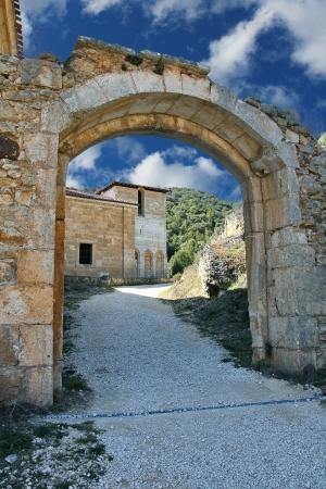stone arch in San Pedro de Arlanza in the province of Burgos, Spain photo