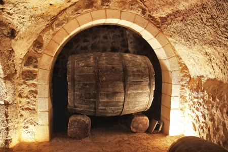 old wine barrel in a cellar photo