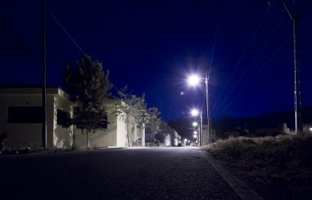 a village street at night photo