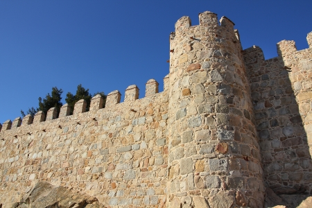 ancient buildings: old wall surrounding the city Avila, Spain Editorial