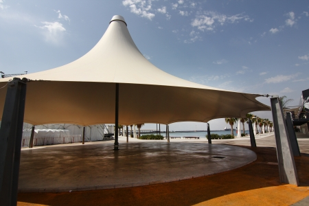 huge white tent as an umbrella Stock Photo