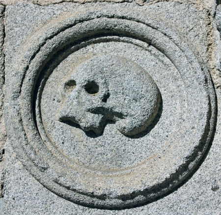 skull carved in stone on a facade photo