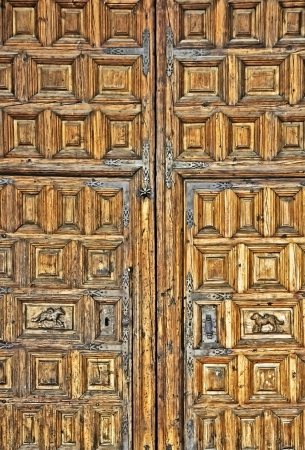 old wooden door in front of a house photo