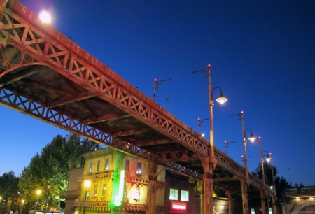 night old bridge of iron oxidized with street lamps photo