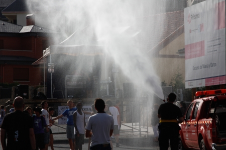 freshening: a fire truck handles freshening and the public during the start of the festival