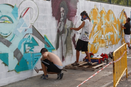 Madrid, SPAIN Sep 18 - graffiti artists work on their creations to the public during the festival - Graffiti and Dance  first festival, Aqui huele a pintura ,Spain September 2012