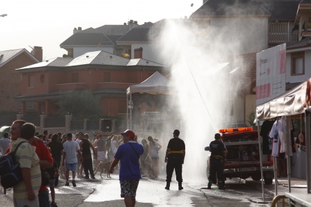 a fire truck handles freshening and the public during the start of the festival