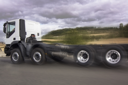 truck running at high speed under the clouds photo