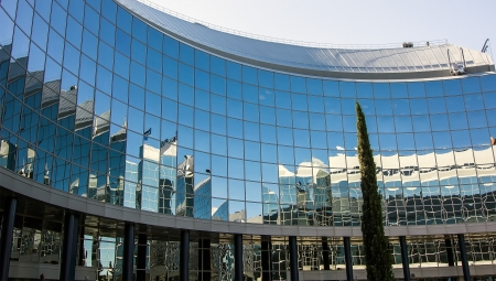 recently: MADRID, SPAIN OCT 15: Modern building with glass architecture on October 15 2012, In one of the most modern financial areas of Madrid, recently premiered this modern complex of offices for rent.