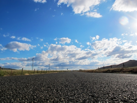 nice country road with blue sky and white clouds background photo