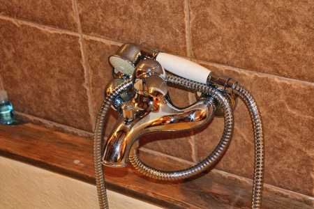 bathtub faucet with stone background photo