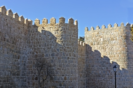 crenellated tower: old wall surrounding the city Avila, Spain Stock Photo