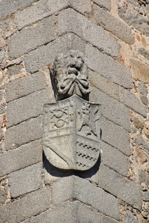 ancient medieval shield in the corner of a stone house photo
