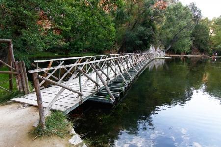 on a quiet lake floating wooden bridge Stock Photo - 17846445