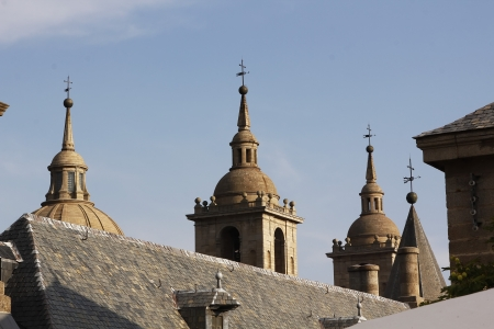 protrude: Monastery of the Escorial steeples, roofs protrude between, In Madrid, Spain