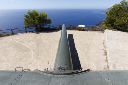 battery of coastal artillery of a powerful cannon in impressive perspective Stock Photo - 18574577
