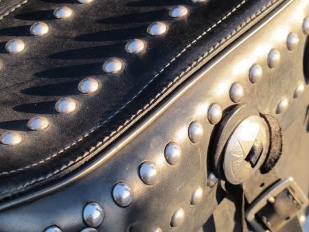 saddlebag: black motorcycle saddlebag with rivets