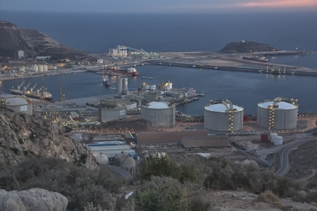 overview of a refinery with oil deposits in the evening