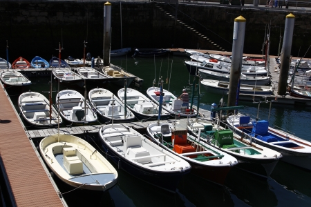 fishing boats moored at port photo