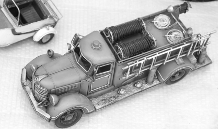 nice old toy fire truck in wood photo