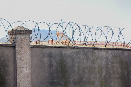 concrete walls with barbed wire for above Stock Photo