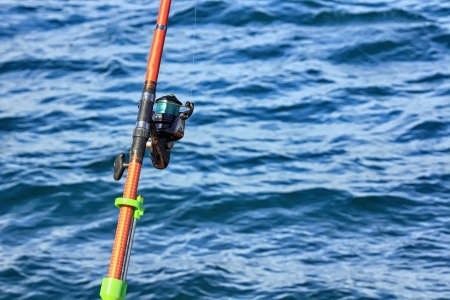 hand line fishing: foreground reel a fishing rod Stock Photo