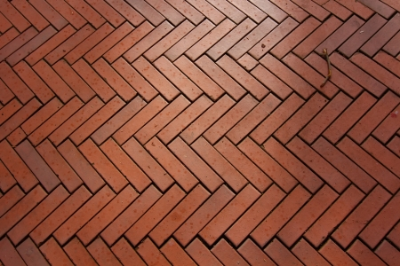 background made with red bricks in a herringbone photo