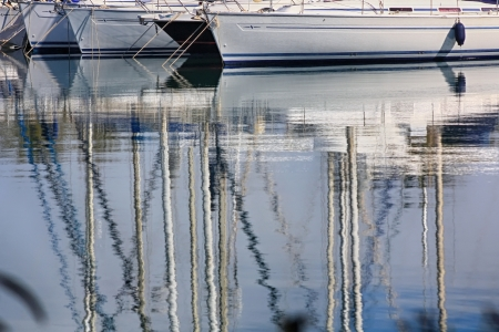 reflections in the calm water sailing boats photo