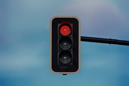 Modern traffic lights with LED lights in red photo