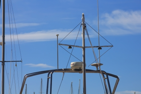 mast with radar and radio antennas small boat photo