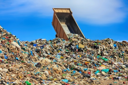 recycle plastic: unloading truck in a mountain of trash Stock Photo