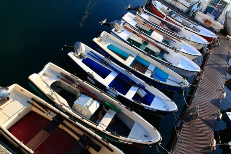 many rowing boats and fishing engine nice colors photo