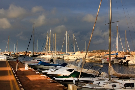 modern marina filled with sailboats docked photo