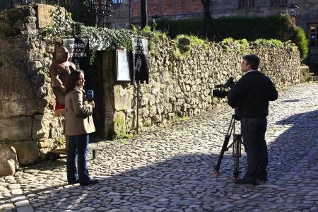 news cast: Santillana del Mar, SPAIN Mar 25: Unit Radio Television Española working on the street with presenter and camera of mobile on March 25, 2013 in Santillana del Mar