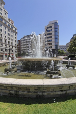 Ornamental fountain in a large square in the center of the city of ociedo, Spain
