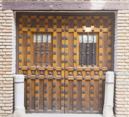 old wooden door with iron ornaments photo