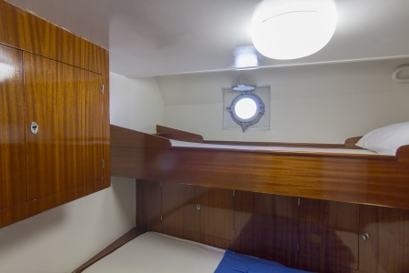 small cabin with porthole on a ship Stock Photo