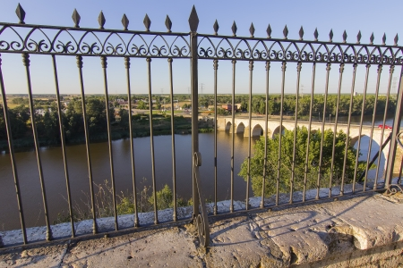 elegant iron fence overlooking a river photo