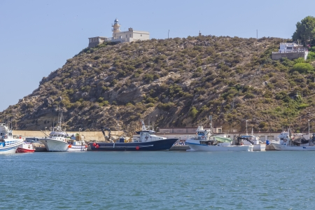 lighthouse and small fishing port in the town of Mazarron, Spain photo